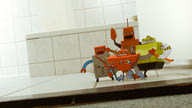 A mob of cardboard boxes made into tiny robots.