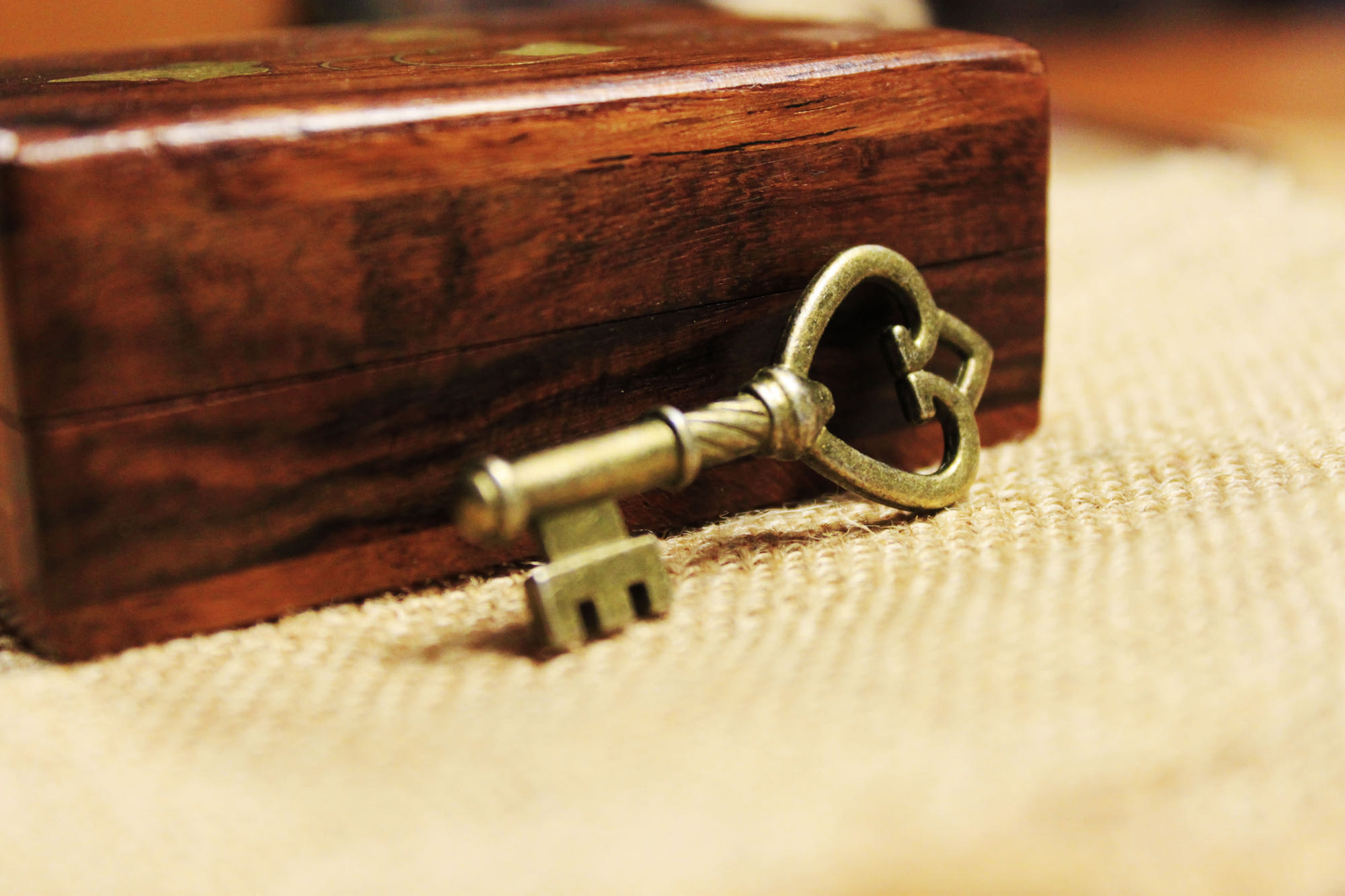 Brass key and wooden box