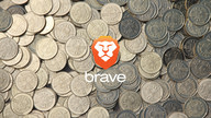 The Brave logo in front of a pile of Bitcoin tokens.