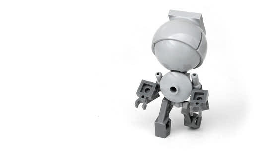 A small robot with a large head made out of Lego bricks.
