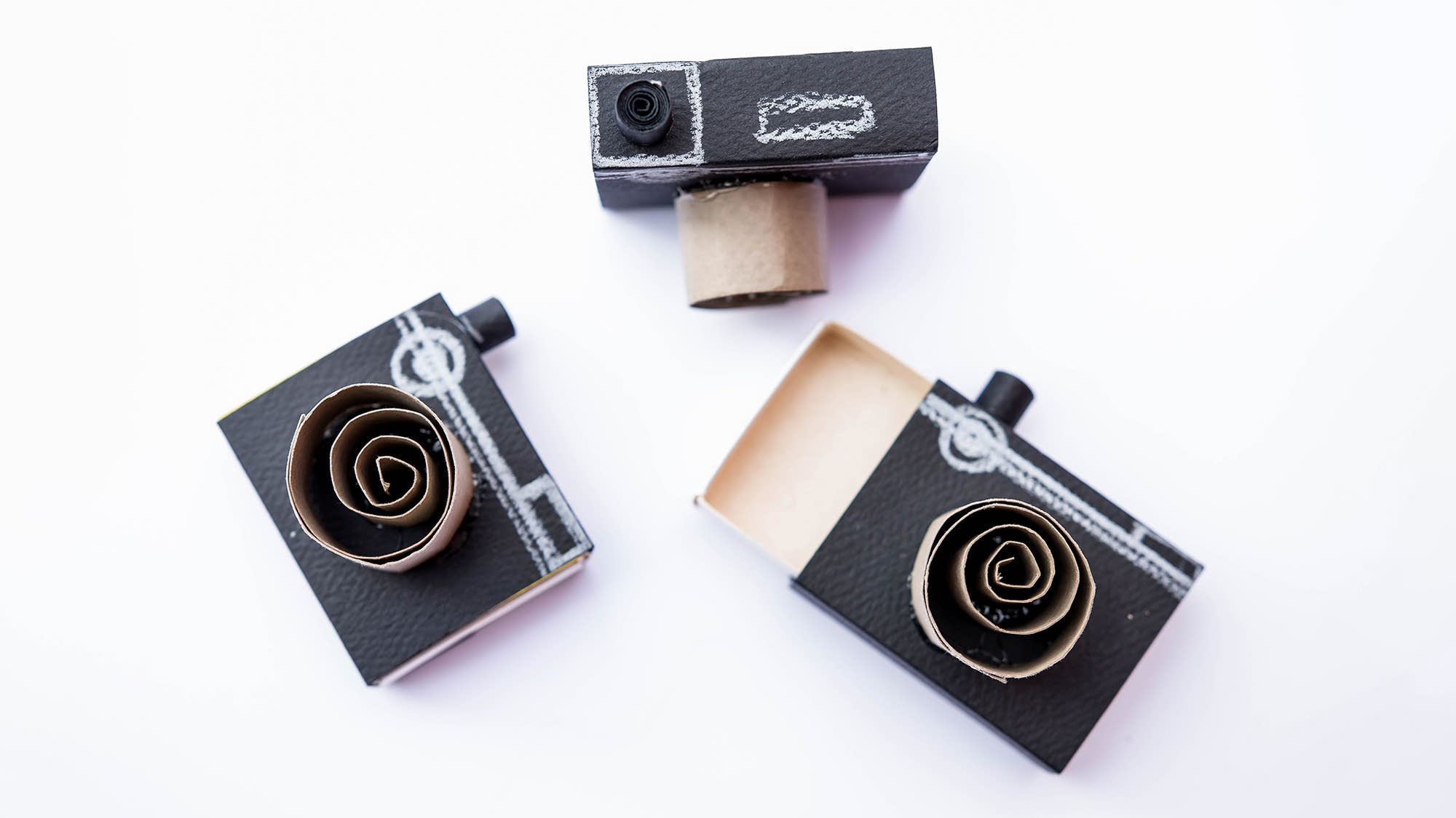 Three cameras made out of cardboard.