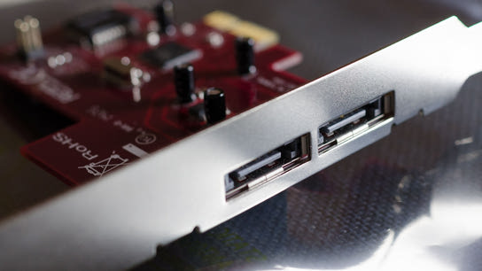 A close-up of two external eSATA ports and the shield of a PCIe card.