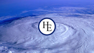 The Hurricane Electric logo situated above the eye of a hurricane shown in the background.