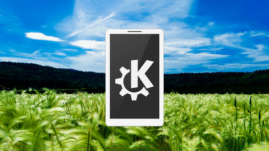 A smartphone with the KDE logo on the screen hovering above a wheat field.
