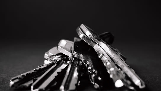 A close-up of a pair of keys in black and white.