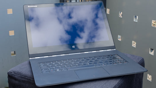 A Lenovo Yoga 3 Pro reflecting clouds from the sunset on the screen.