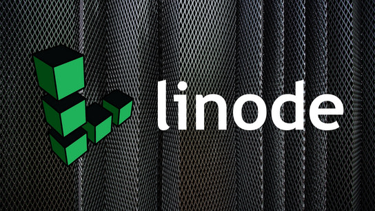 The Linode logo with some metal sheets in the background.