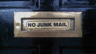 "A door with a letter-plate labeled ""No Junk Mail""."