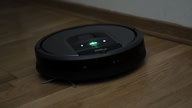 A Roomba 960 cleaning the floor in the dark.