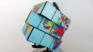 A square globe world-map shaped like a Rubik's cube.