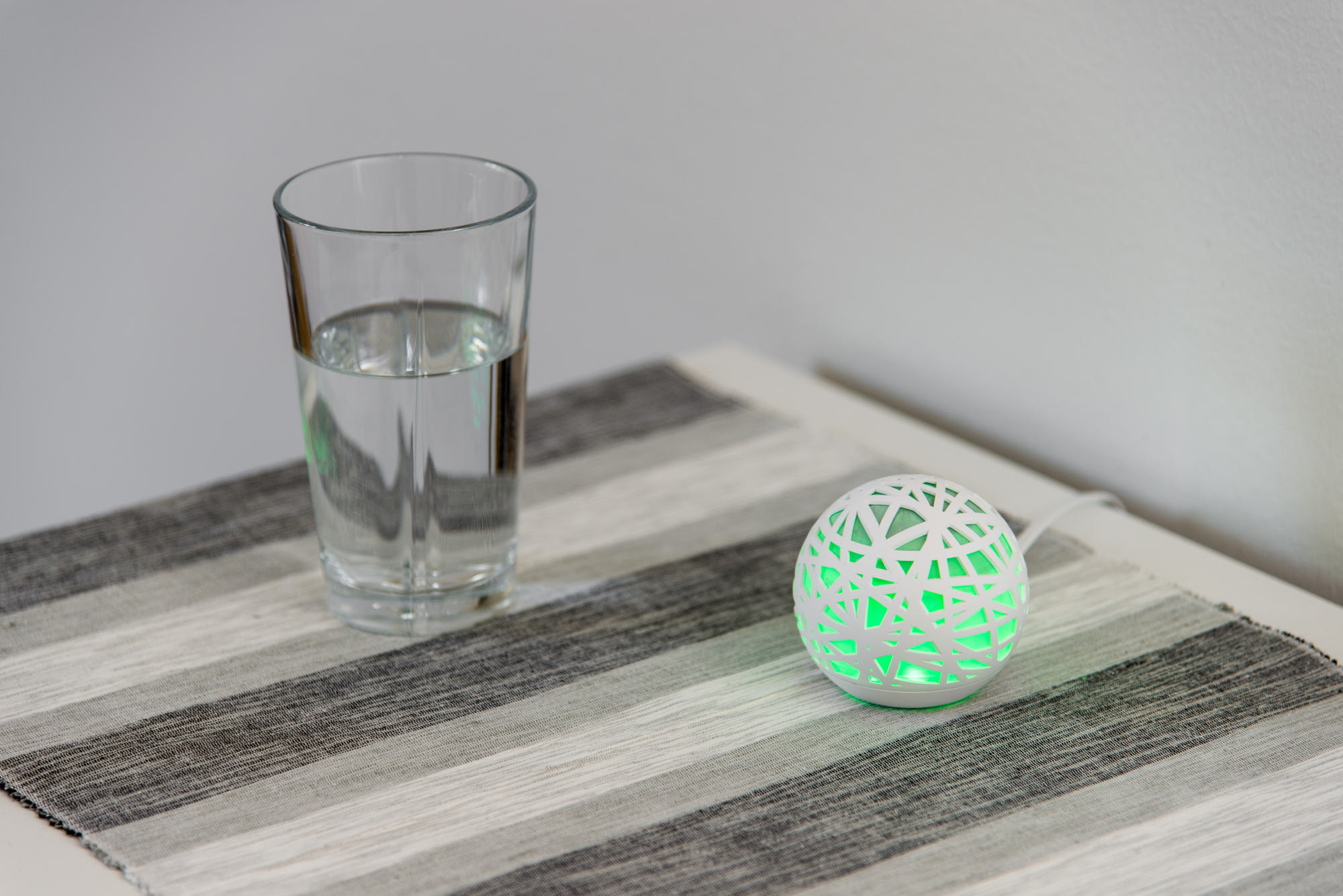 Sense sleep tracker on bedside table
