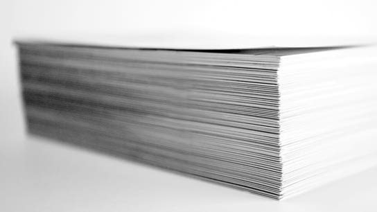 A stack of white paper sheets.