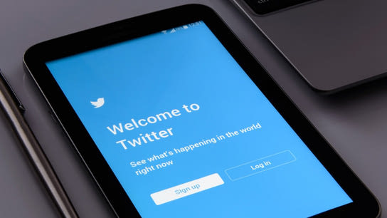 A tablet computer showing the Twitter app's first-run screen welcoming new users to Twitter.