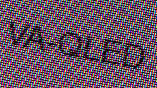 "A close-up photo of the word ""VA-QLED"" on a VA-QLED display panel."